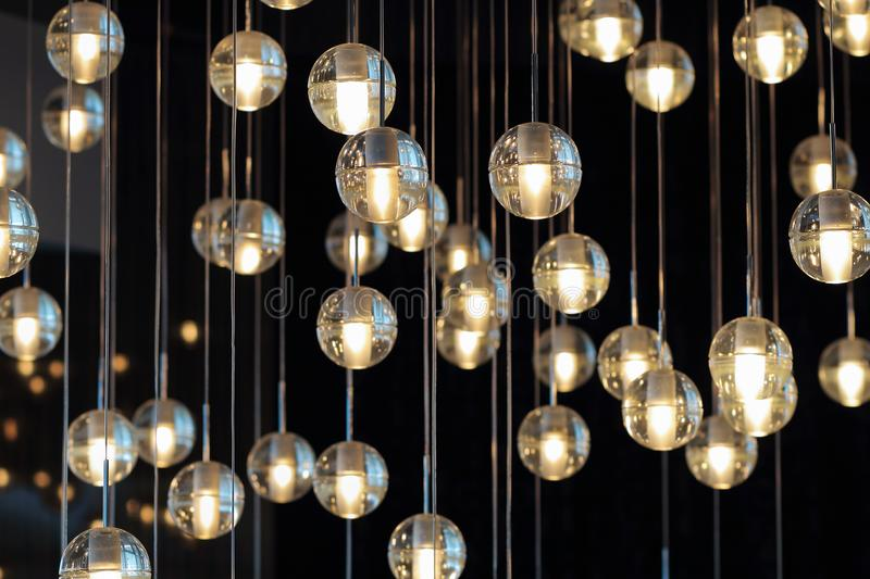 Lighting balls on the chandelier in the lamplight light bulbs download lighting balls on the chandelier in the lamplight light bulbs hanging from the ceiling aloadofball Image collections