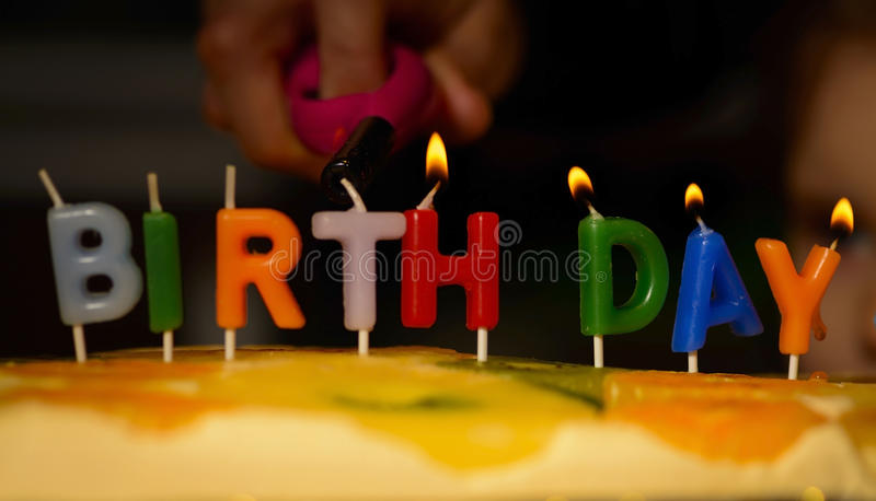 Lighting the birthday candles royalty free stock images