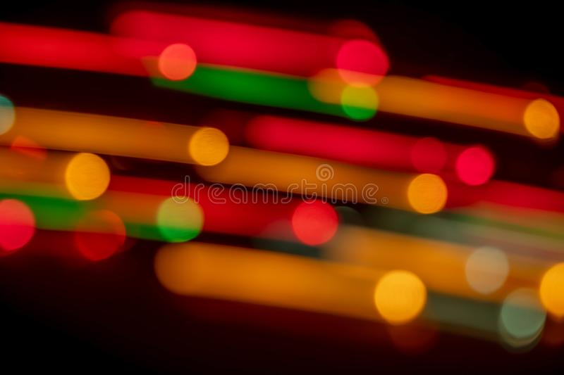 Lighting Bokeh dark background. Abstract backdrop bar beautiful black blue blur blurred blurry bright celebration christmas circle city color colorful stock photo