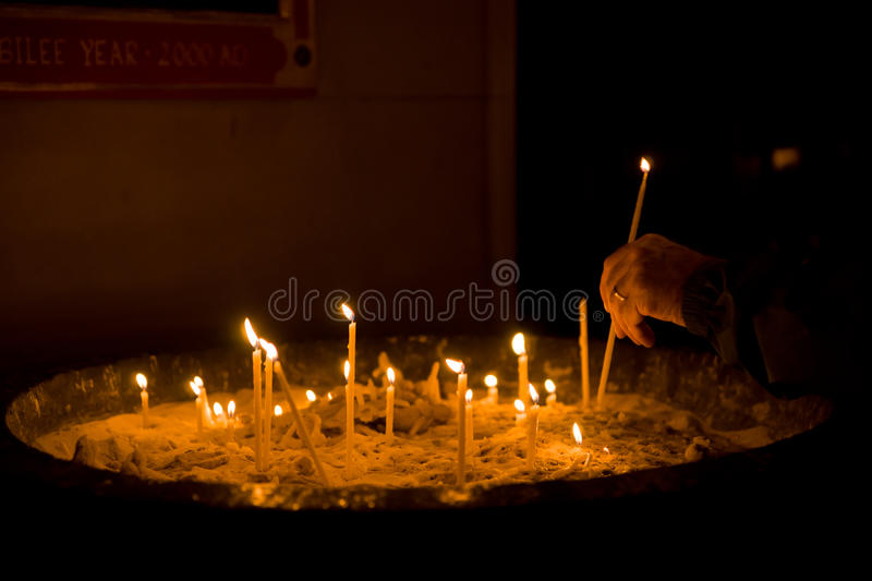 Lighting candle royalty free stock photo