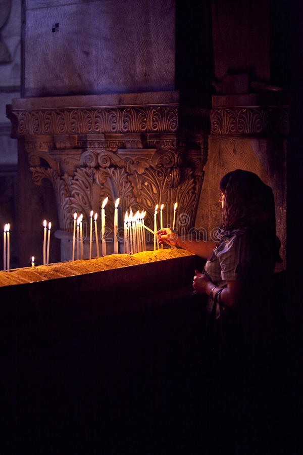 Lighting candles at the Church of the Holy Sepulchre. Jerusalem, israel stock images
