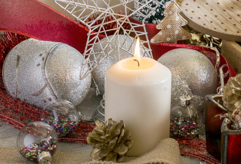 Lighting Christmas candle royalty free stock images