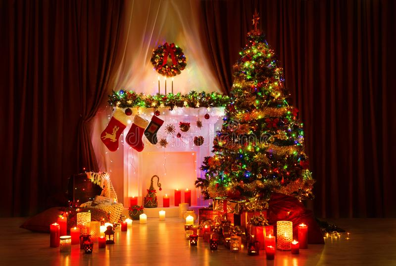 Lighting Christmas Tree, Xmas Fireplace and Stockings, New Year royalty free stock photos