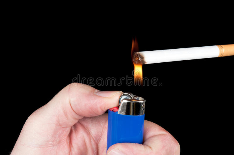 Lighting A Cigarette Stock Image