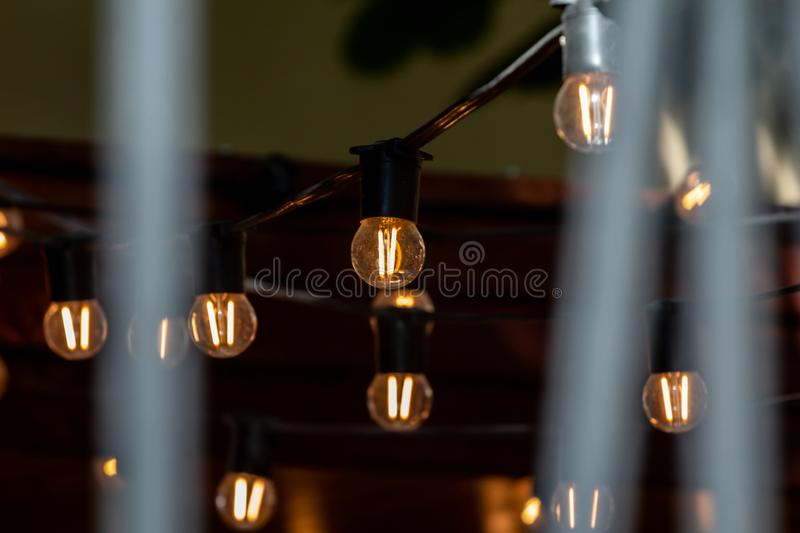 Lighting decor vintage light bulb decoration of lighting in the restaurant and cafe. Old vintage light bulb decoration of lighting in the restaurant and cafe stock photo
