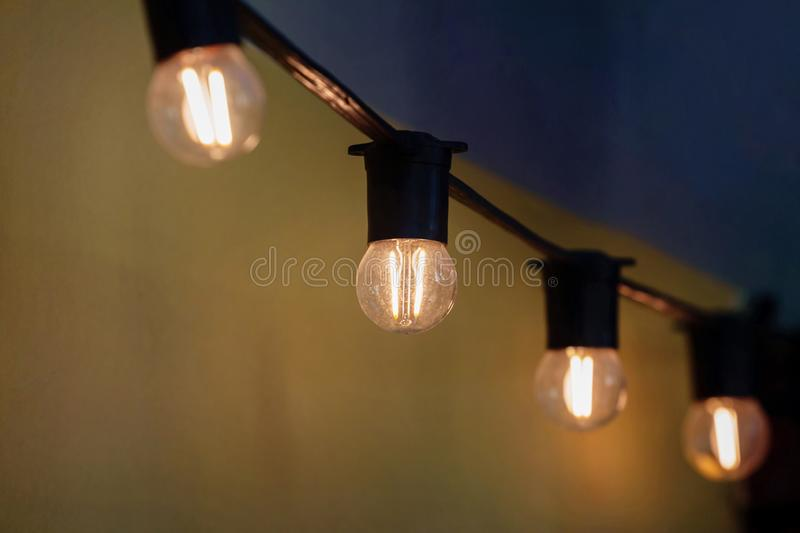 Lighting decor vintage light bulb decoration of lighting in the restaurant and cafe. Old vintage light bulb decoration of lighting in the restaurant and cafe royalty free stock photo