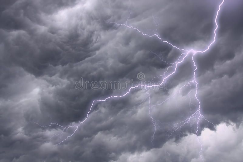 Lighting in a dramatic stormy sky. Lighting in a dark stormy clouds stock photos