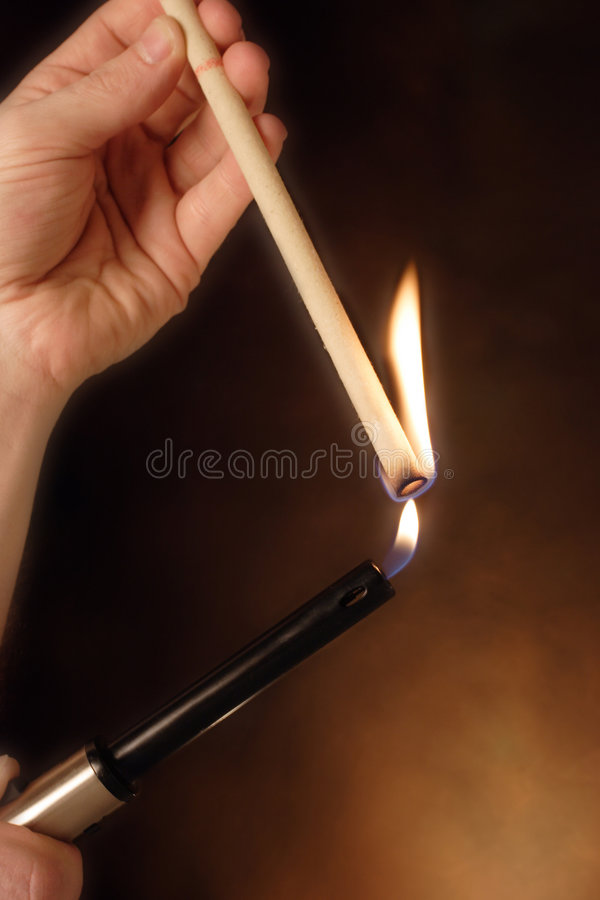 Download Lighting an ear  candle stock image. Image of hand, healthy - 712861