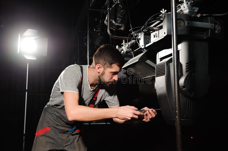 The lighting engineer adjusts the lights on the stage royalty free stock photos