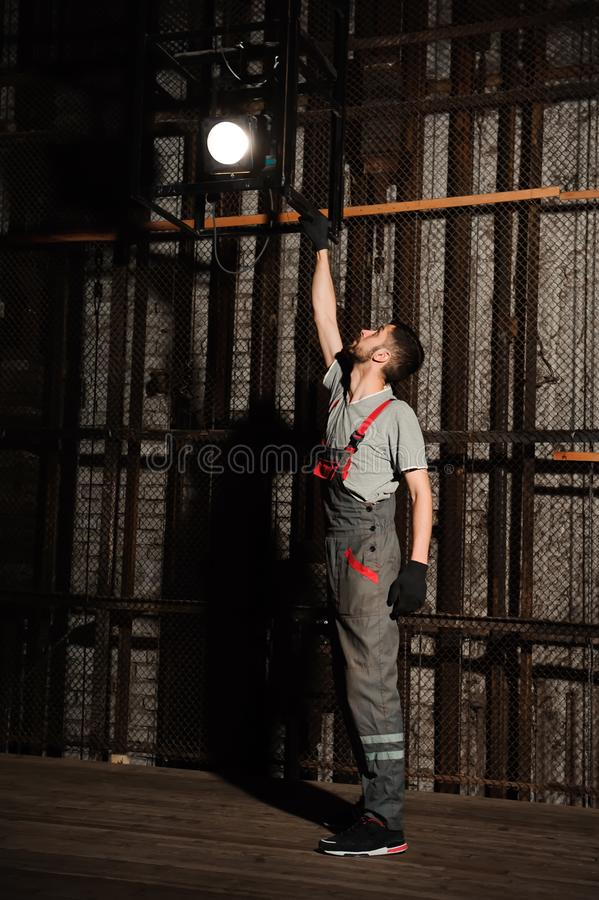 The lighting engineer adjusts the lights on stage behind the scenes. royalty free stock images