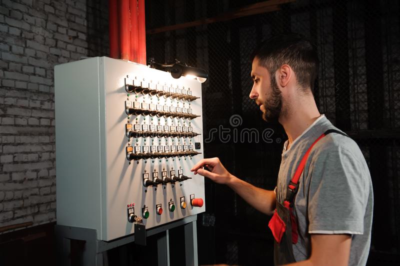 The lighting engineer adjusts the lights on stage behind the scenes. royalty free stock photos