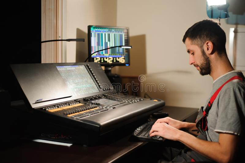 A Lighting Engineer Works With Lights Technicians Control On