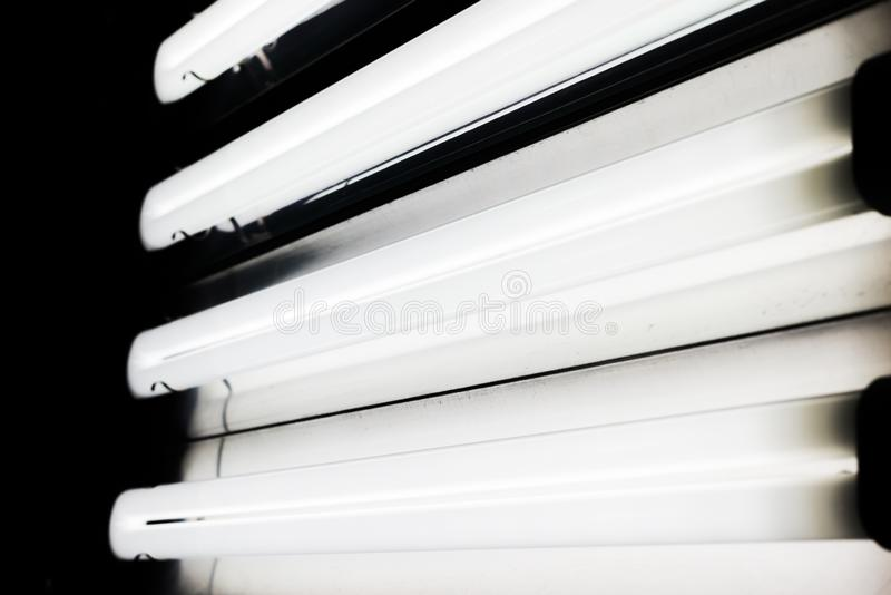 Lighting equipment for photo or video production. fluorescent light tubes. stock image