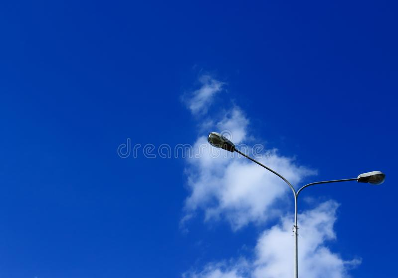 Street lights against the sky stock photography