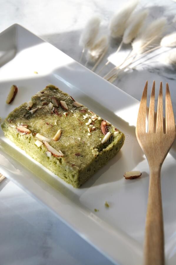 Lighting on Matcha Brownie on White Plate royalty free stock photography