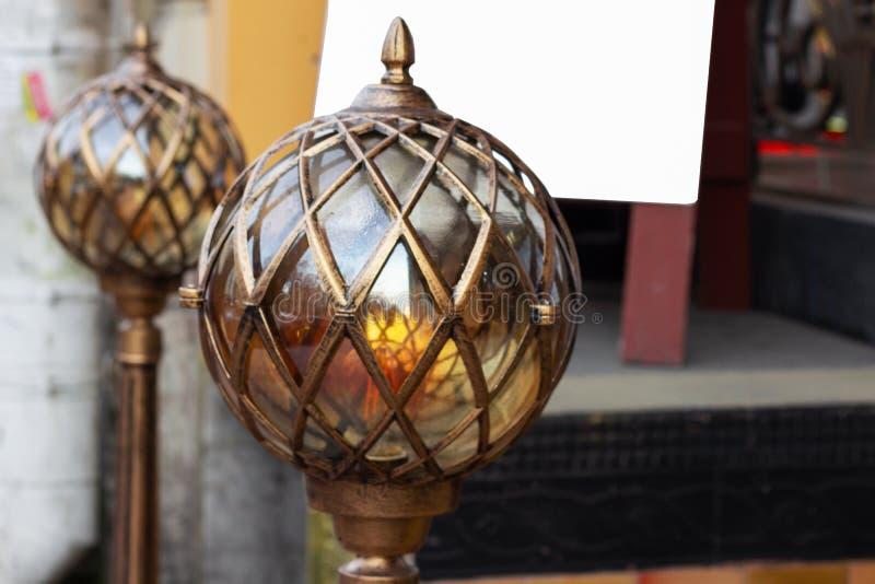 Lighting metal spherical lantern. futuristic retro vintage lamp royalty free stock image