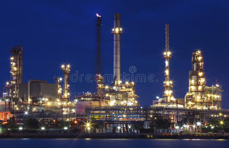 Lighting of oil refinery plant in heavy industry estate against. Beautiful dusky sky use for petrochemical industrial and fuel energy business royalty free stock image