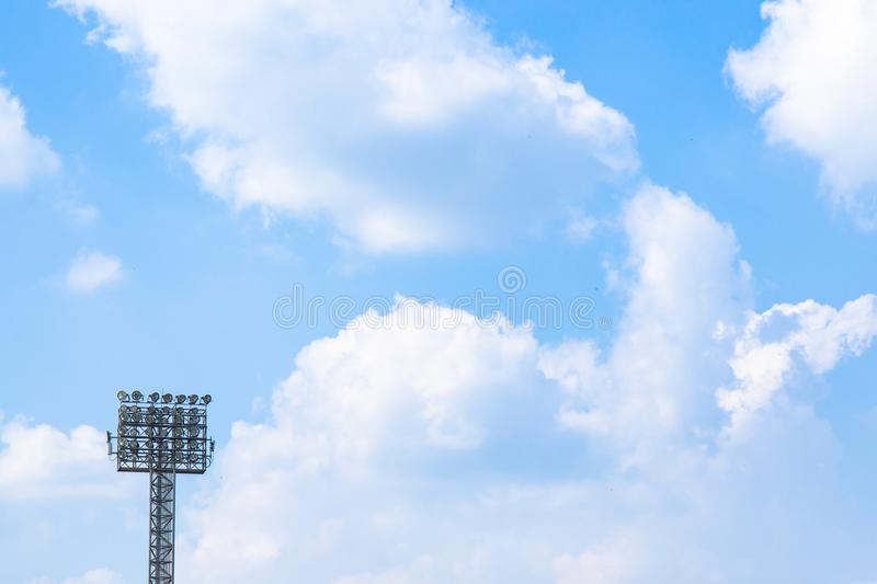 Lighting or Spotlight tower of stadium on sky and cloud background. Sport background stock photography