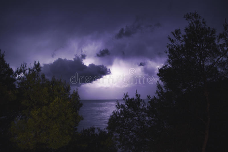 Lighting storm with purple shades. stock photography