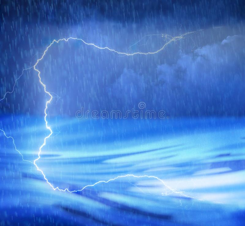 A lighting storm on the water with rain and waves stock photos