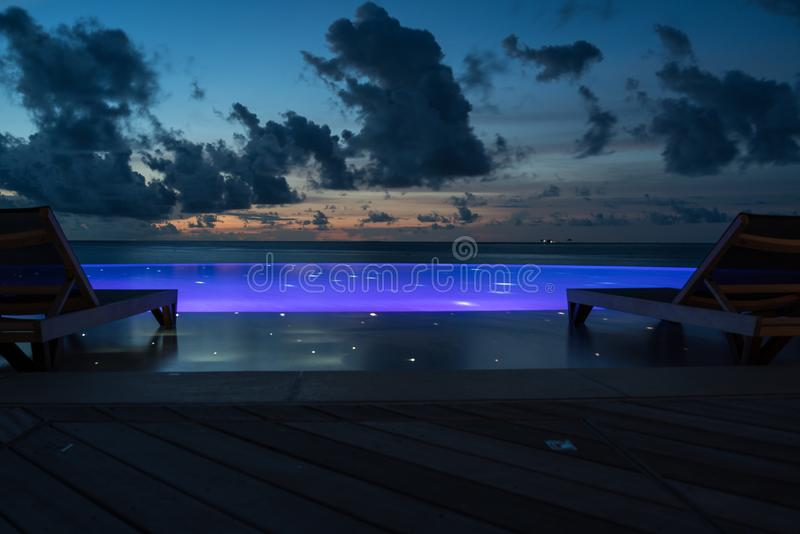 Lighted pool at night stock photography