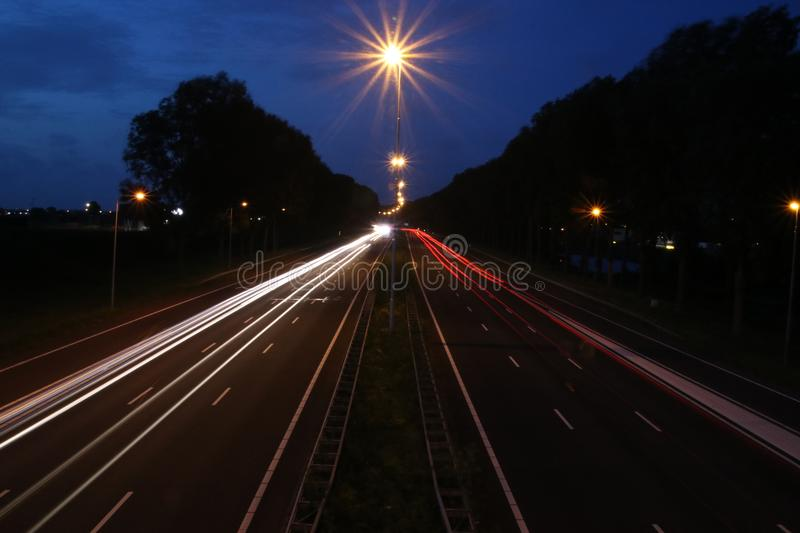 Lightlines at highway A20 at Nieuwerkerk aan den IJssel with high shutter opening time and high diagragma stock photography