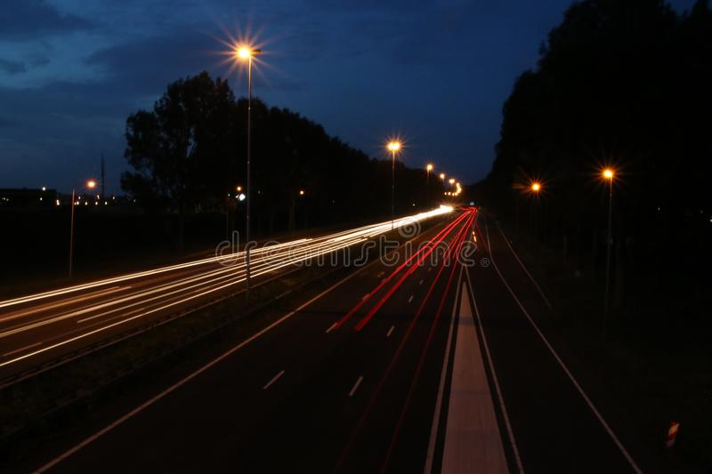 Lightlines at highway A20 at Nieuwerkerk aan den IJssel with high shutter opening time and high diagragma royalty free stock images
