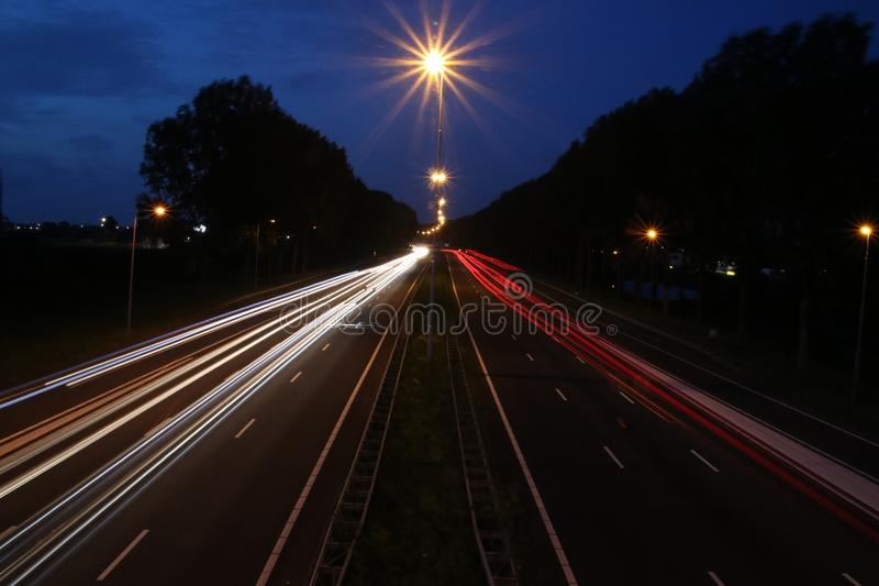 Lightlines at highway A20 at Nieuwerkerk aan den IJssel with high shutter opening time and high diagragma stock photo