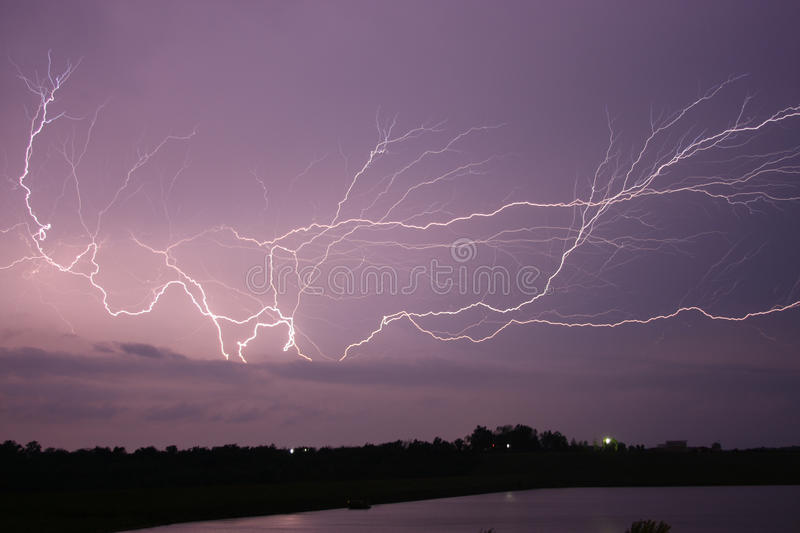 Download Lightning across the sky stock image. Image of finger - 24816225