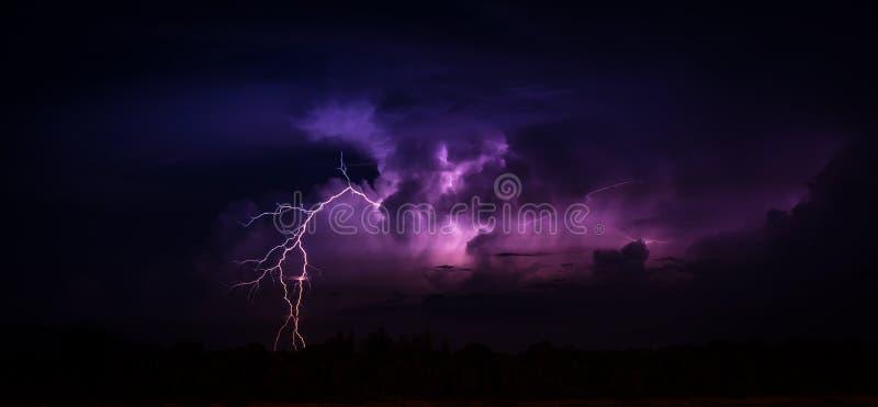 Lightning in the big cumulonimbus cloud stock image