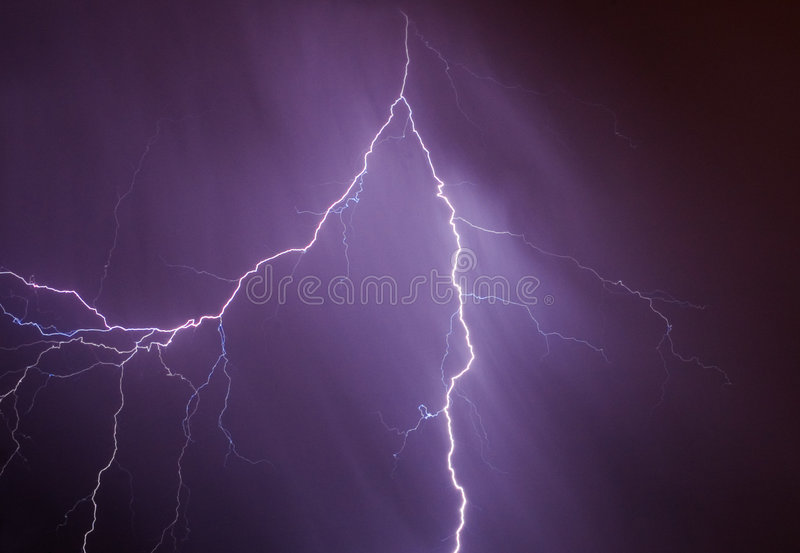 Lightning bolt. In the raining sky stock image