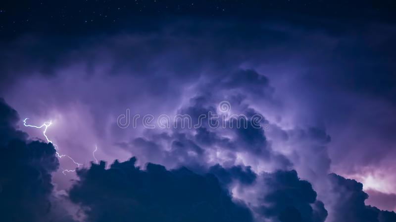 Lightning Bolt in Dark Storm Clouds. Background royalty free stock image