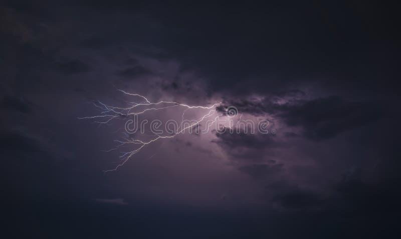 Lightning bolt at night stock images