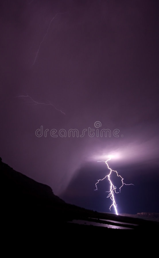 Lightning bolt in rural mountains royalty free stock photography