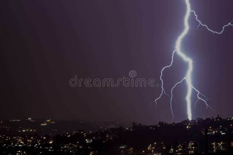 Lightning bolt storm at night in the city. A beautiful ightning bolt storm at night in the city stock photography