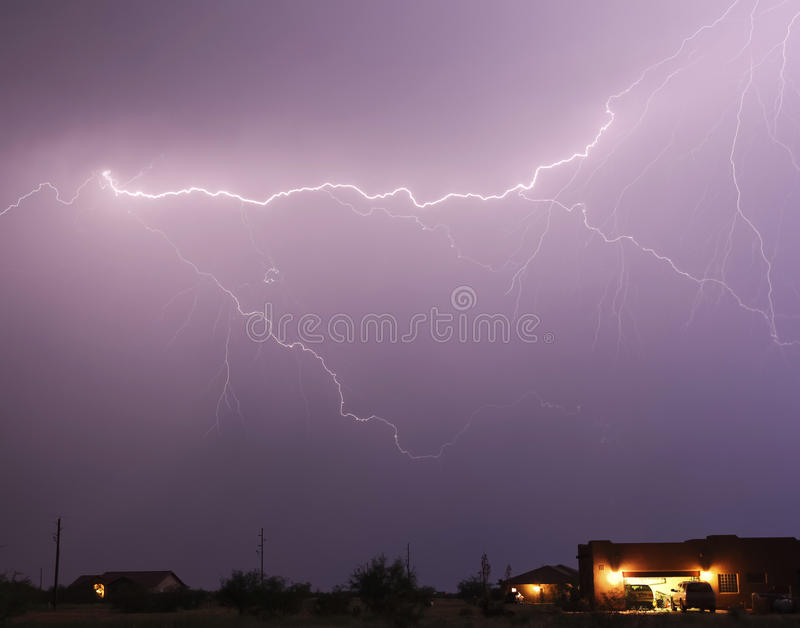 Download A Lightning Bolt Streaks Above A Neighborhood Stock Photo - Image of house, natural: 26650696