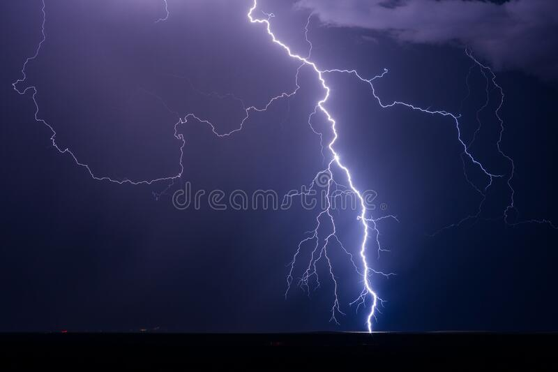Lightning bolt strike from an electrical storm. At night. Thunderstorm sky stock photo