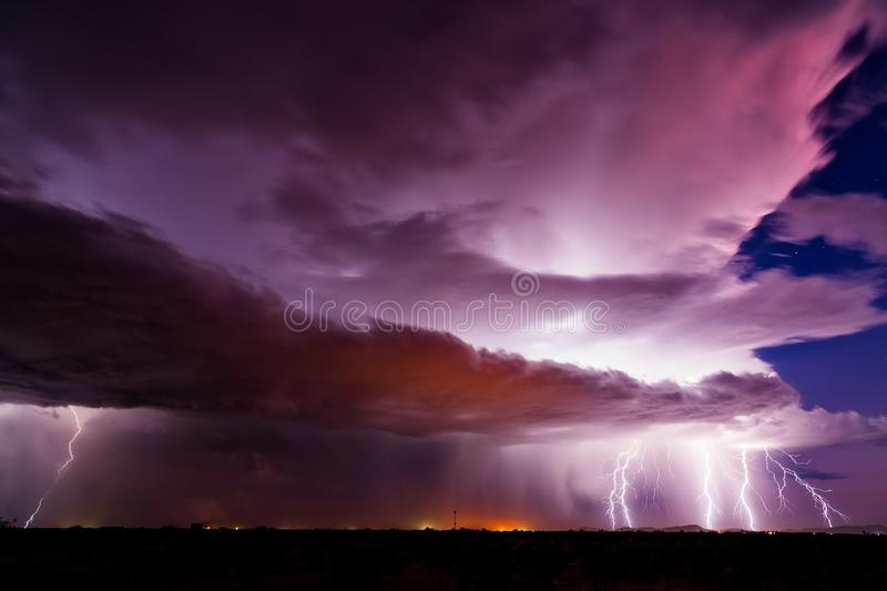 Lightning bolt strikes from a powerful thunderstorm. Lightning bolt strikes and colorful storm clouds from a powerful thunderstorm in Arizona royalty free stock photo