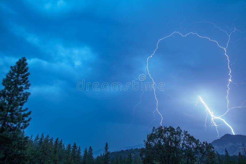 Lightning bolt strikes. In this spectacular early morning shot. Oregon, Ashland, Cascade Siskiyou National Monument, Taken 08.14, Copyright David Hoffmann royalty free stock image