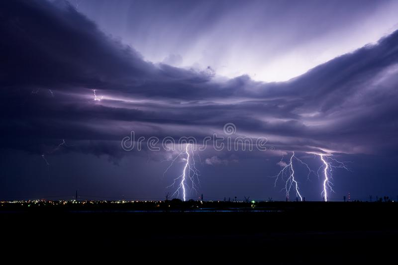 Lightning bolts from an approaching thunderstorm. Lightning bolts strike from dramatic storm clouds ahead of an approaching severe thunderstorm near Snyder royalty free stock photo