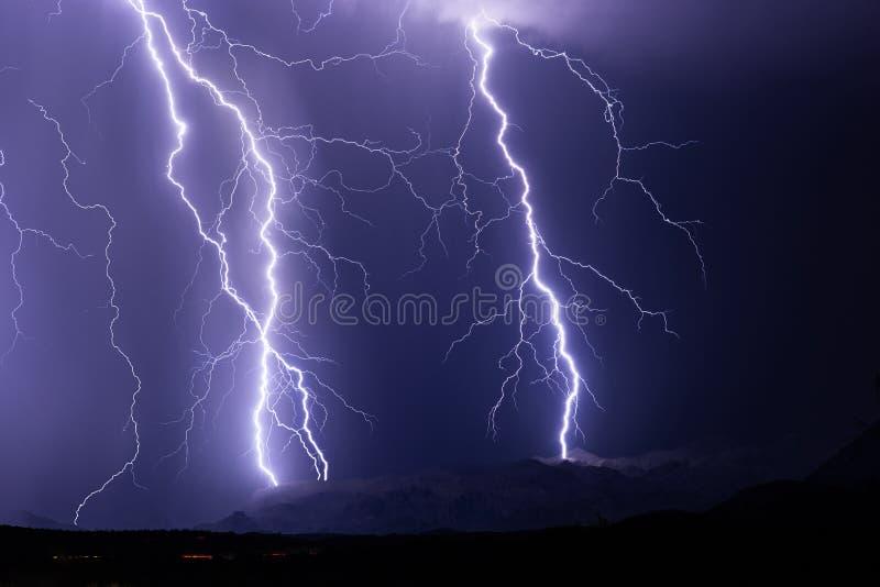 Lightning bolts strike a mountain during a thunderstorm. Near Phoenix, Arizona stock photography