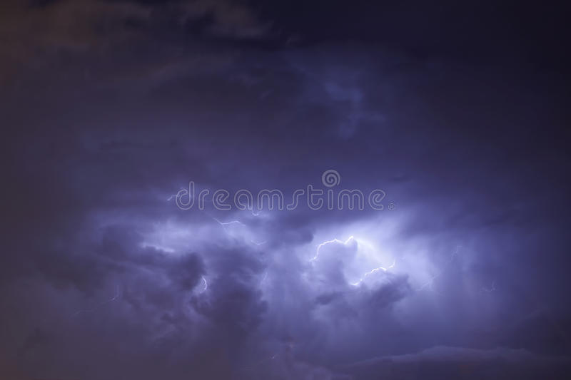 Lightning in Dark Storm Clouds. Lightning Bolt coming from Dark Storm Clouds royalty free stock image