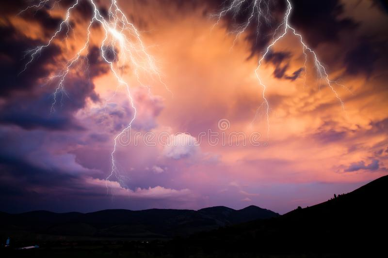 lightning on dark stormy sky - summer storm - bad weather forecast - warning stock photos