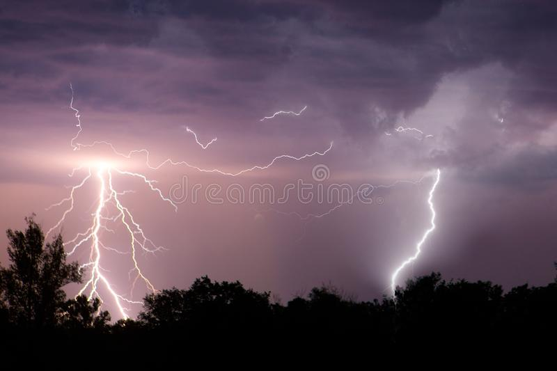 Lightning with dramatic clouds. Night thunder storm.  royalty free stock photography