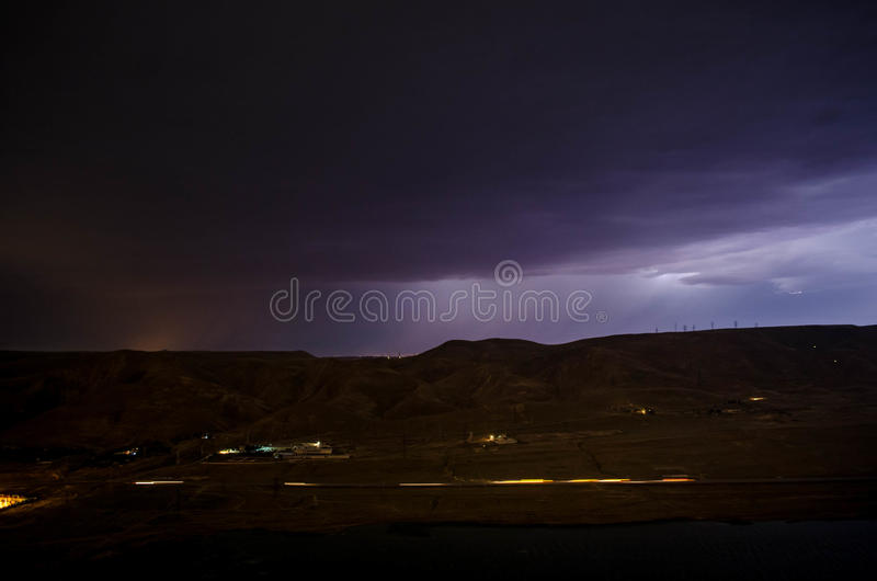 Lightning with dramatic clouds. Night thunder-storm over the mountain and the lake in Baku, Azerbaijan royalty free stock images