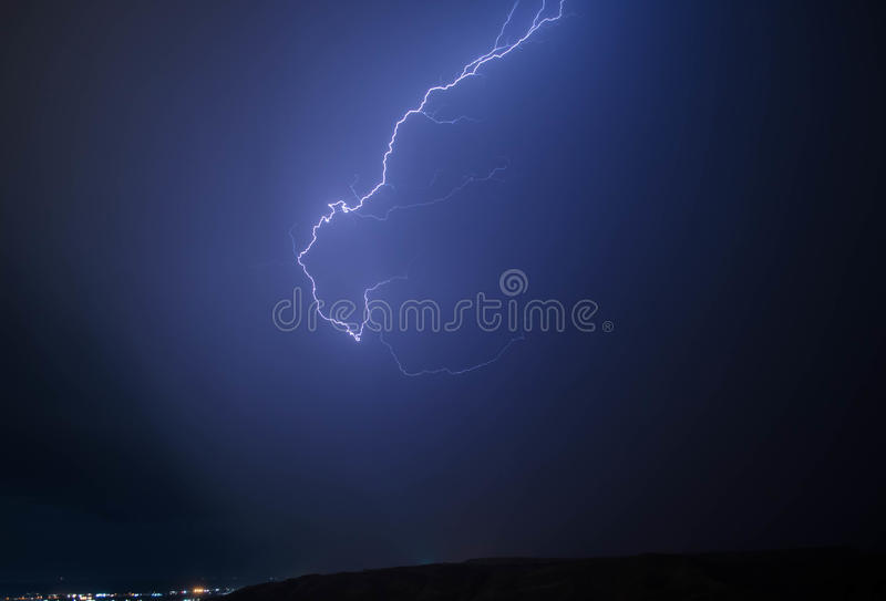 Lightning with dramatic clouds. Night thunder-storm over the mountain and the lake in Baku, Azerbaijan stock photos