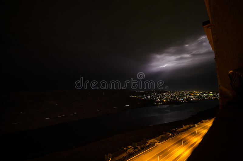 Lightning with dramatic clouds. Night thunder-storm over the mountain and the lake in Baku, Azerbaijan royalty free stock image