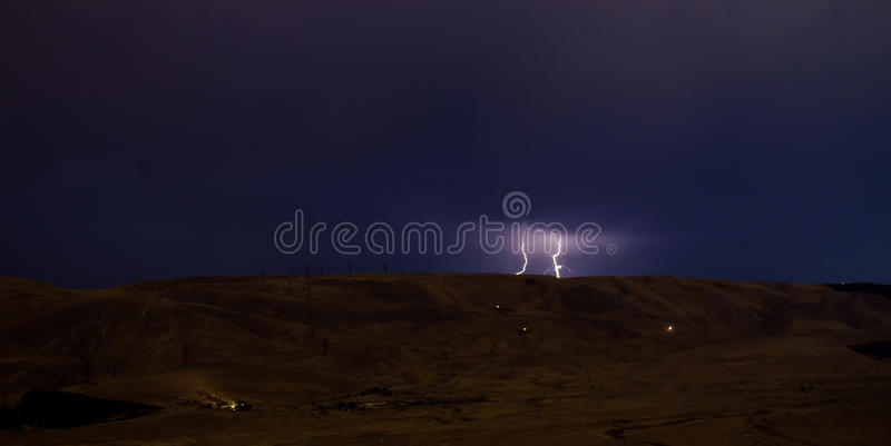 Lightning with dramatic clouds. Night thunder-storm over the mountain and the lake in Baku, Azerbaijan royalty free stock photo