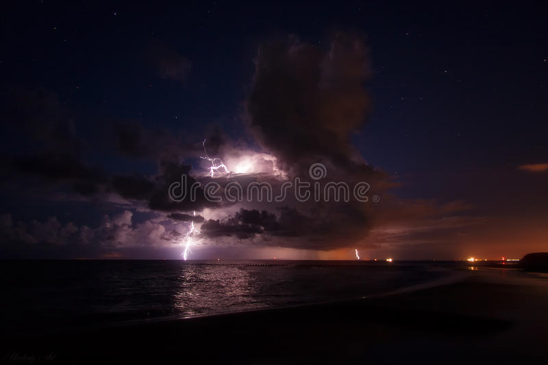 Lightning flash. Storm cloud over the baltic sea with lightning stock photos