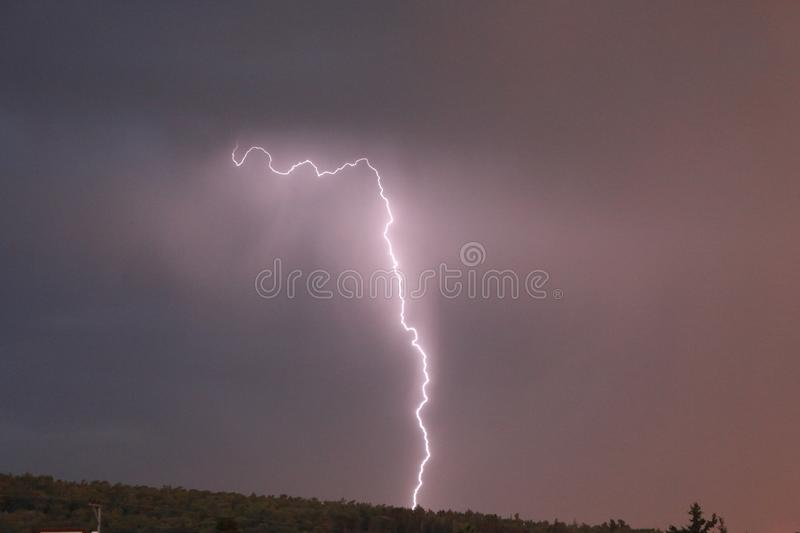 Lightning hits a forest near my city. stock image